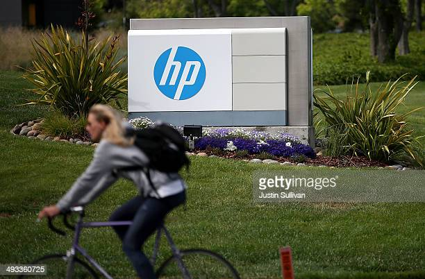 A cyclist rides by a sign outside of the HewlettPackard headquarters on May 23 2014 in Palo Alto California HP announced on Thursday that it plans to...