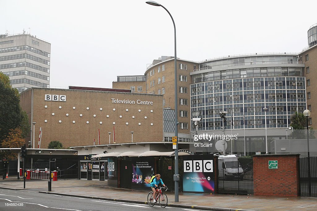 A cyclist rides by BBC Television Centre on October 22, 2012 in London, England. The BBC producer in charge of a Newsnight documentary into sexual abuse allegations concerning Sir Jimmy Savile, the transmission of which was subsequently dropped, had warned his editor that the BBC could be accused of a cover-up. Police confirmed that the Sir Jimmy Savile, 84, the BBC presenter and DJ who died in October 2011, may have sexually abused young girls on BBC premises.