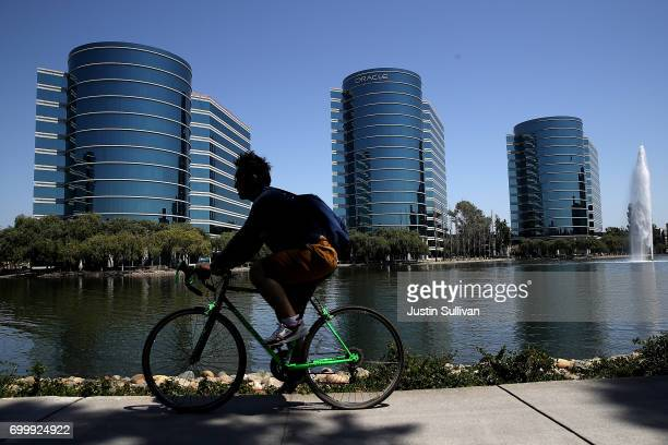 A cyclist rides by Oracle headquarters on June 22 2017 in Redwood Shores California Oracle reported better than expected fourth quarter earnings with...