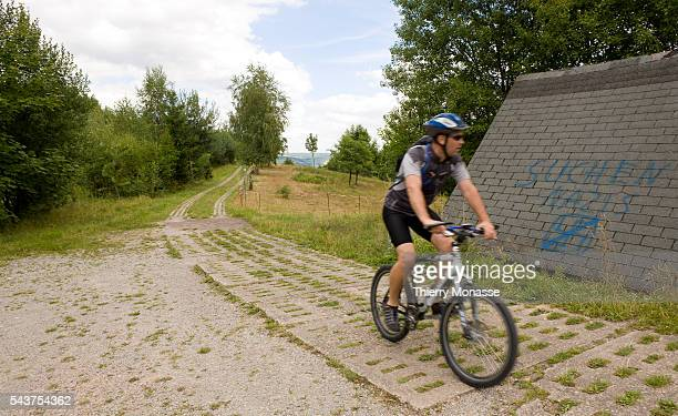 A cyclist rides his bicycle on the former border patrol road between East and West Germany The German Democratic Republic or East Germany was a...