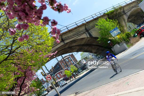 cyclist rides in manayunk, philadelphia - basslabbers, bastiaan slabbers stock pictures, royalty-free photos & images