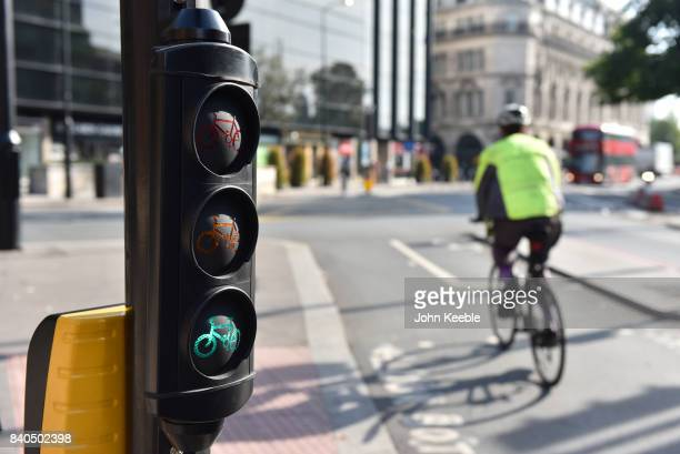 Cyclist rides pass a set of cycle traffic lights on the EastWest Cycle Superhighway near Tower Hill on August 28 2017 in London England