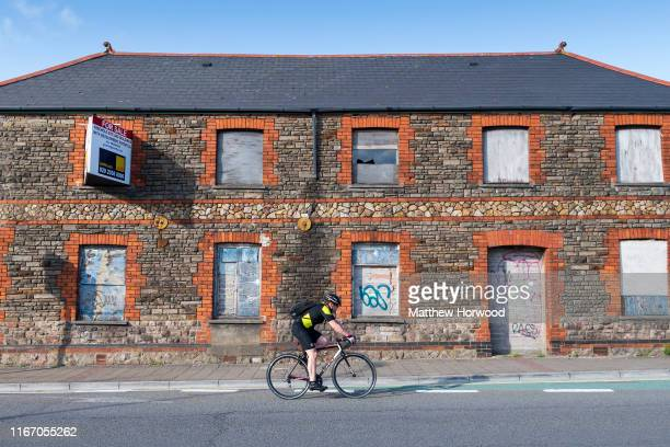 A cyclist rides past a boarded up retail unit on July 8 2019 in Cardiff United Kingdom