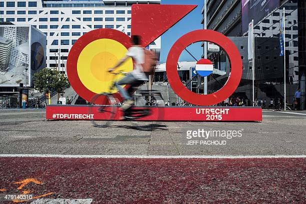 A cyclist rides past a giant sculpture of bike the logo of 'Utrecht 2015' in a street of Utrecht The Netherlands on July 1 three days before the...
