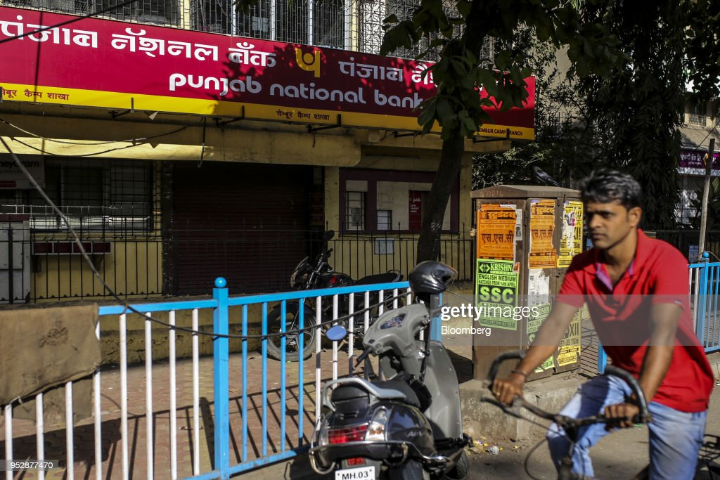 A cyclist rides past a Punjab National Bank branch in Mumbai India on Sunday April 22 2018 PNB is scheduled to announce full year earnings on May 16..