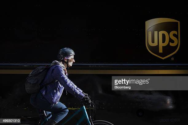 A cyclist rides past a United Parcel Service Inc truck on Cyber Monday in New York US on Monday Nov 30 2015 Online sales on Cyber Monday may rise at...
