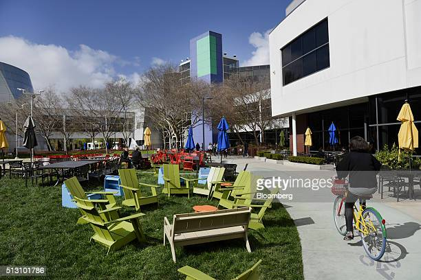google inc office. A Cyclist Rides Past Google Inc Offices Inside The Googleplex Headquarters In Mountain View California US Office