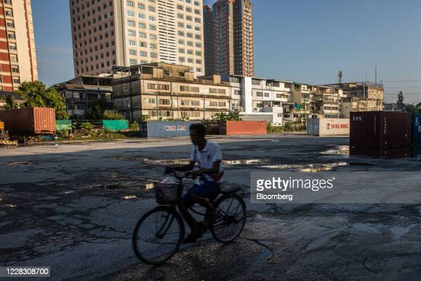 A cyclist rides past shipping containers at the site of a former depot in Bangkok Thailand on Wednesday Sept 2 2020 Thailand has reported zero...