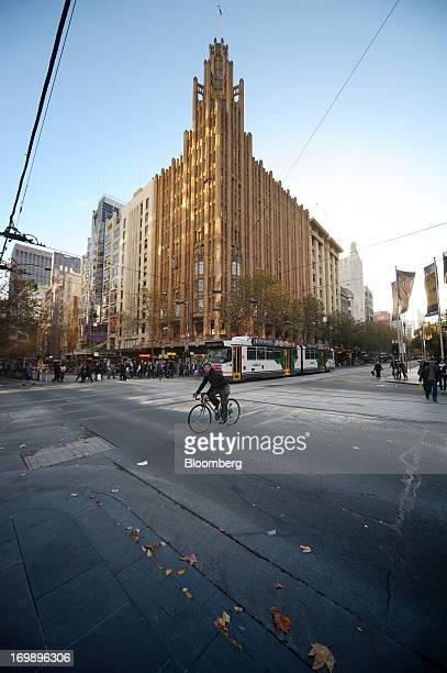 A cyclist rides past the Manchester Unity building at the intersection of Collins Street and Swanston Street in central Melbourne Australia on Sunday...