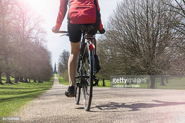 Cyclist rides through parkland in North Yorkshire