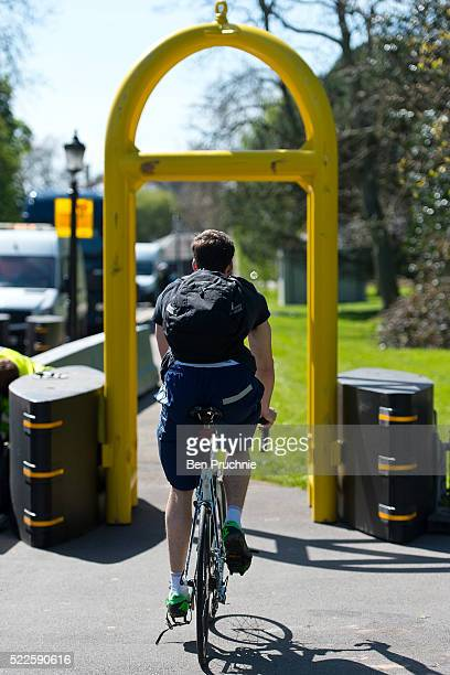 A cyclist rides through security barriers outside Winfield House in Regents Park ahead of US President Barack Obama's visit to the UK on April 20...