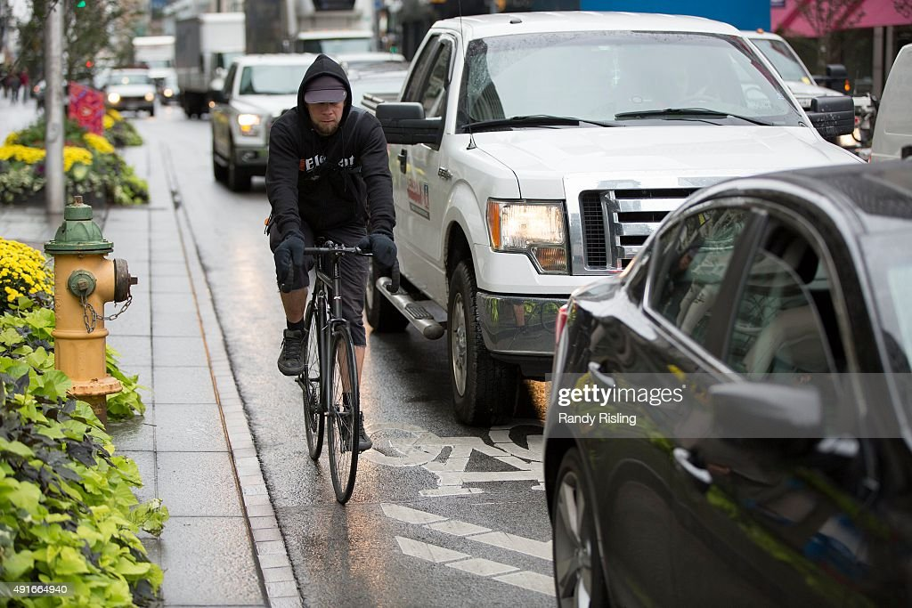 Cycling On Bloor Street : News Photo
