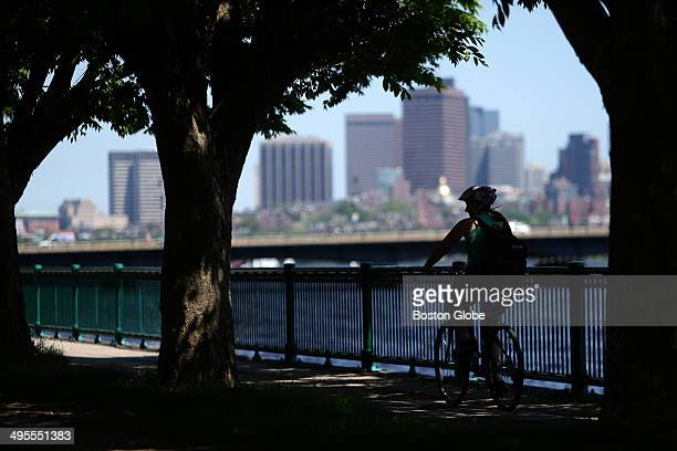 A cyclist rides toward the Massachusetts Avenue bridge along the Charles River in Cambridge The National Weather Service website called for a high of...