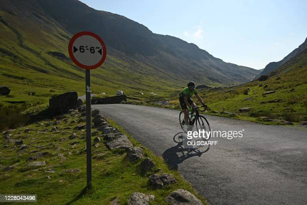 Cyclist rides up Honister Pass in the Lake District in north west England on August 14 as many people take advantage of the seasonal weather to...