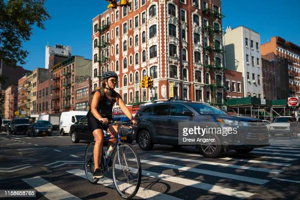 Cyclist rides with morning traffic on the Lower East Side on July 30, 2019 in New York City. As the nation's largest city tries to balance an...