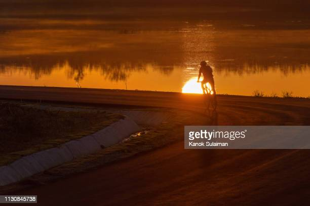 cyclist riding a bicycle - provincia di songkhla foto e immagini stock