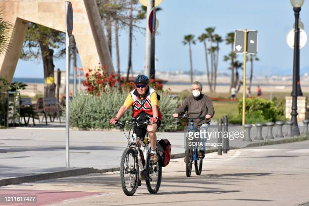 A cyclist riding along the beach in Vendrell Spain lifts some of the state of alarm restrictions in which people can go out to do individual sports...