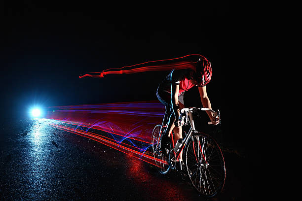 Cyclist Riding At Night Leaving Streaks Of Light Wall Art