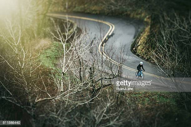 Cyclist Riding Historic Highway