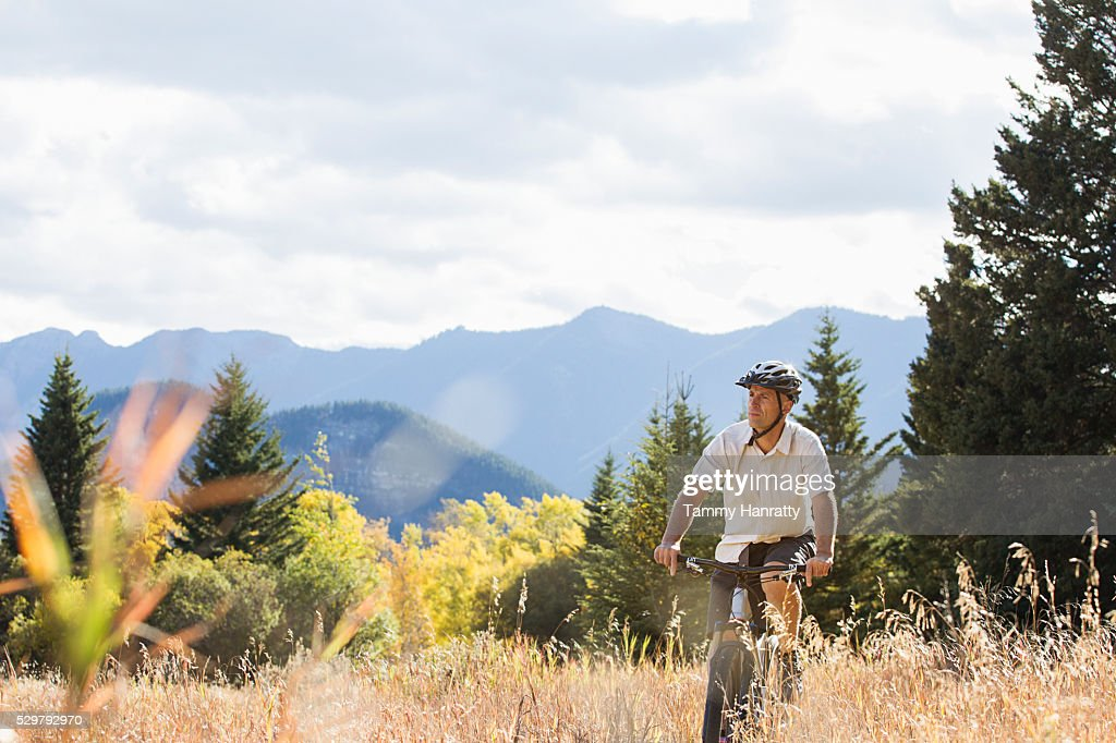 Cyclist riding in mountains : Stock Photo