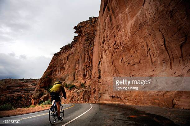 A cyclist riding in rain on Sunday 2000 cyclists travel 45 miles loop of Colorado National Monument in Grand Junction This is Rim Rock Drive the...
