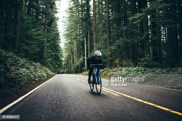 Cyclist Riding Mountain Road on Racing Bike