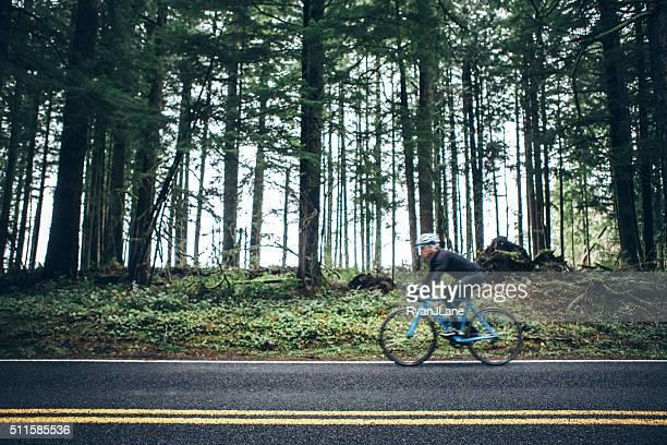 Cyclist Riding Mountain Road