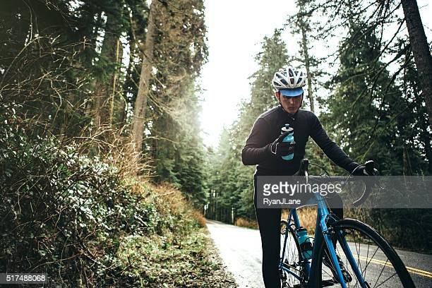 cyclist riding mountain road - road cycling stock pictures, royalty-free photos & images