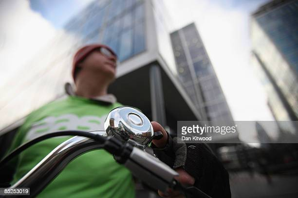 Cyclist rings his bell as he and others perform a 90 second symphony using bicycle bells on March 5, 2009 in London, England. The piece composed by...