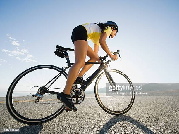cyclist road riding - wielrennen stockfoto's en -beelden