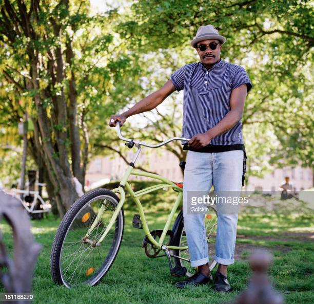 Cyclist standing in park