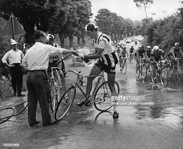A cyclist stops to refill his water bottle during the 16th lap of the Tour of Italy 31st May 1964