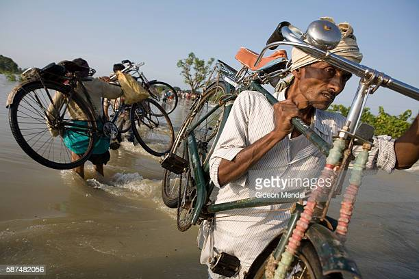 A cyclist struggles to cross a section of the submerged main road between Muzaffarpur and Sitamarhi due to rising floodwaters This is in the province...