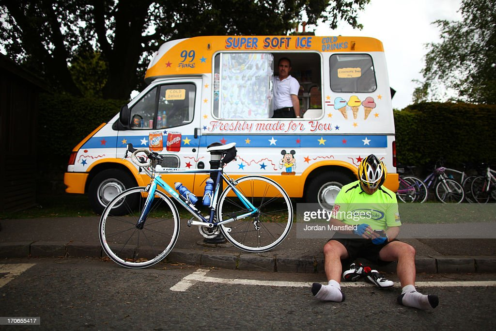 A cyclist takes a break in front of an Ice Cream van during the London to Brighton Bike Ride on June 16, 2013 in Turners Hill, England. Every year since 1980, cyclists gather to ride from Clapham Common in London to the seafront at Brighton to raise money for the British Heart Foundation.