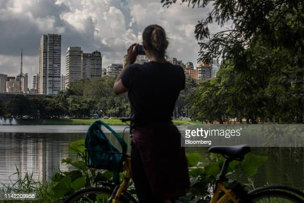 Cyclist takes photos of luxury apartment buildings in the Vila Nova Conceicao neighborhood of Sao Paulo, on Monday, May 6, 2019. The luxury...