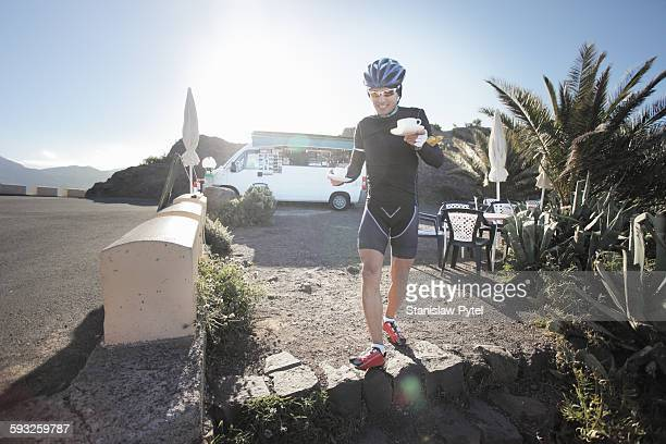 Cyclist taking coffee break