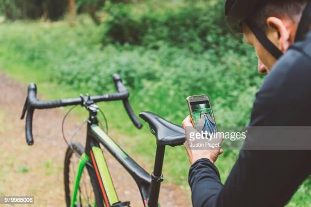 Cyclist taking photo of bike