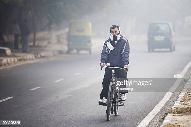 A cyclist travels along a road shrouded in smog in New Delhi India on Monday Jan 11 2016 A 2judge Delhi High Court panel headed by Chief Justice G...