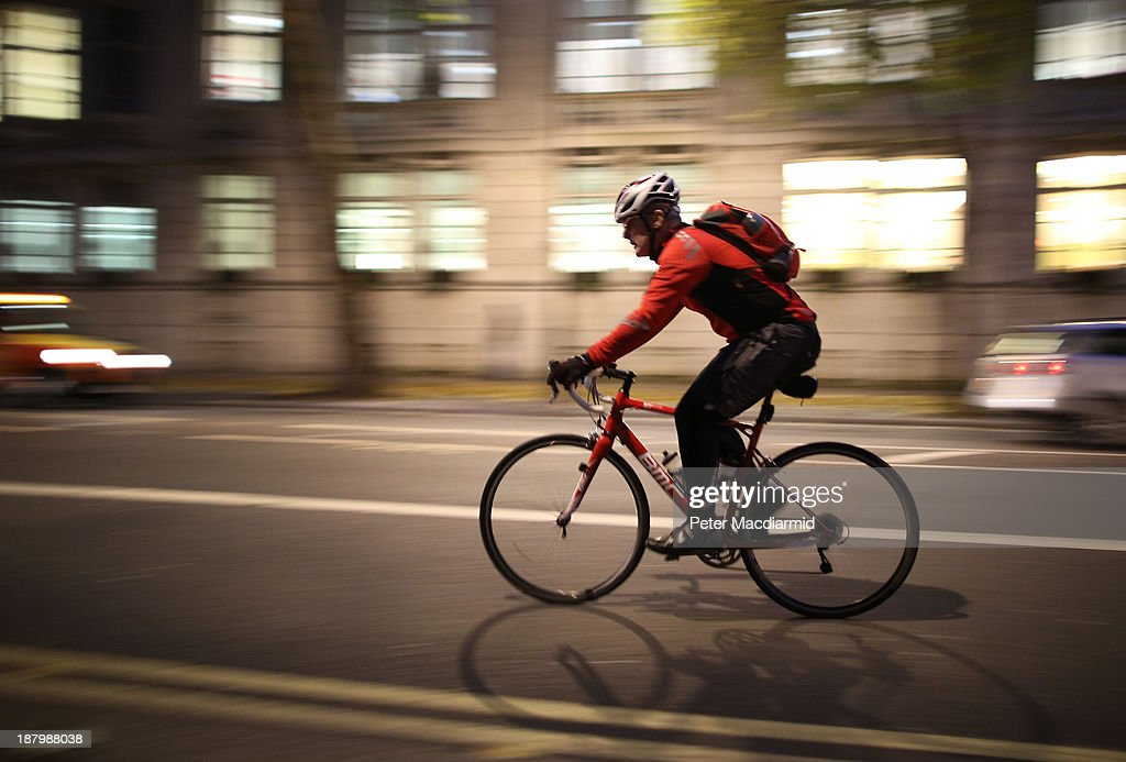 A cyclist travels along a street in the evening rush hour on November 14, 2013 in London, England.