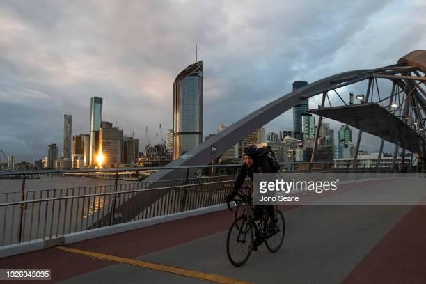 Cyclist travels along Southbank on June 29, 2021 in Brisbane, Australia. Queensland Premier Annastacia Palaszczuk has announced a three-day lockdown...