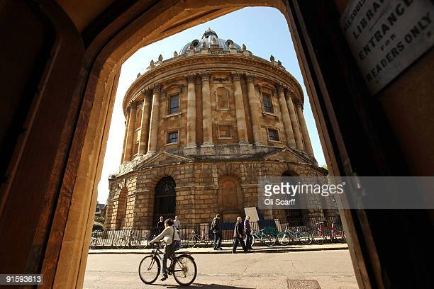 A cyclist travels past the Radcliffe Camera building in Oxford city centre as Oxford University commences its academic year on October 8 2009 in...