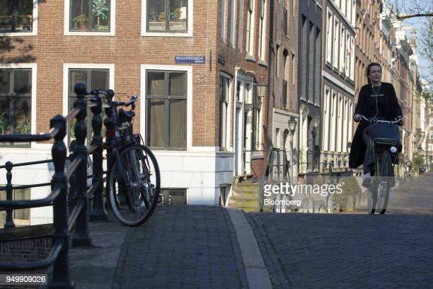 A cyclist travels towards a bridge on the corner of Reguliersgracht and Keizersgracht in Amsterdam Netherlands on Friday April 20 2018 Brexit will...