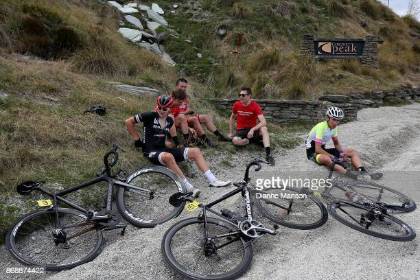 Cyclist try to regain their breath after making the climb to Coronet Peak to finish stage 3 of the 2017 Tour of Southland on November 1 2017 in...