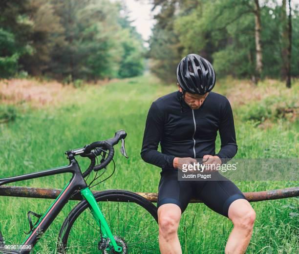Cyclist using smartphone