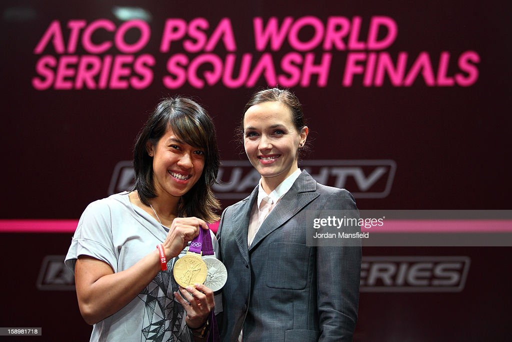 Cyclist Victoria Pendleton holds her Olympic medals with squash player Nicol Matthew of Malaysia during Day 3 of the World Series Finals held at Queens Club on January 4, 2013 in London, England.