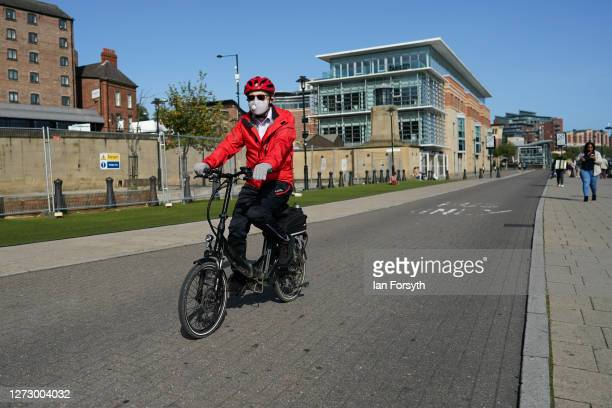 A cyclist wearing a face mask rides along Newcastle quayside on September 17 2020 in Newcastle upon Tyne England Almost two million people in...