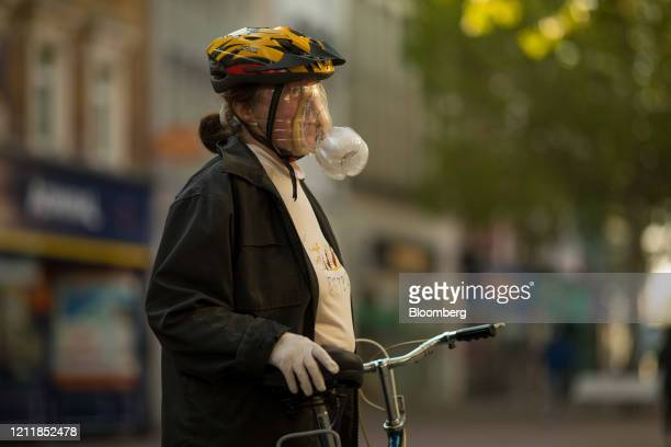 Cyclist wears a homemade protective face mask in Croydon, U.K. On Monday, May 4, 2020. With the economy reeling, U.K. Prime Minister Boris Johnson is...