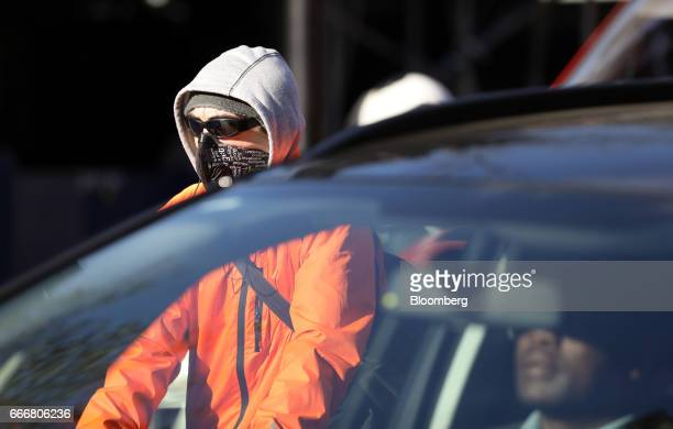 A cyclist wears a protective antipollution mask as they wait at a set of traffic lights in London UK on Monday April 10 2017 London has missed by...