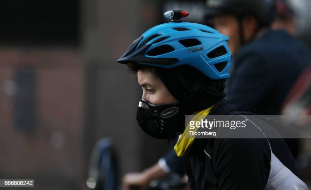 A cyclist wears a protective antipollution mask in London UK on Monday April 10 2017 London has missed by seven years legal deadlines to improve air...