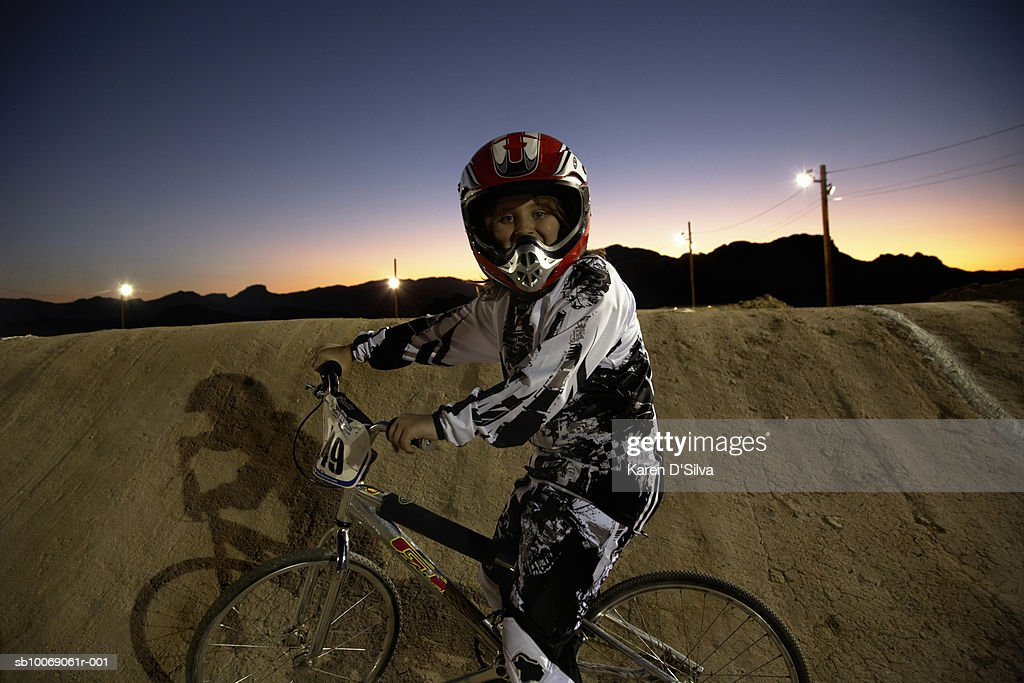 BMX cyclist with bike on track : Stockfoto
